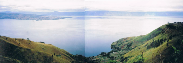 photograph of Lake Toba, deep green valley in foreground