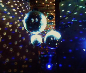 three disco balls and their reflective lights